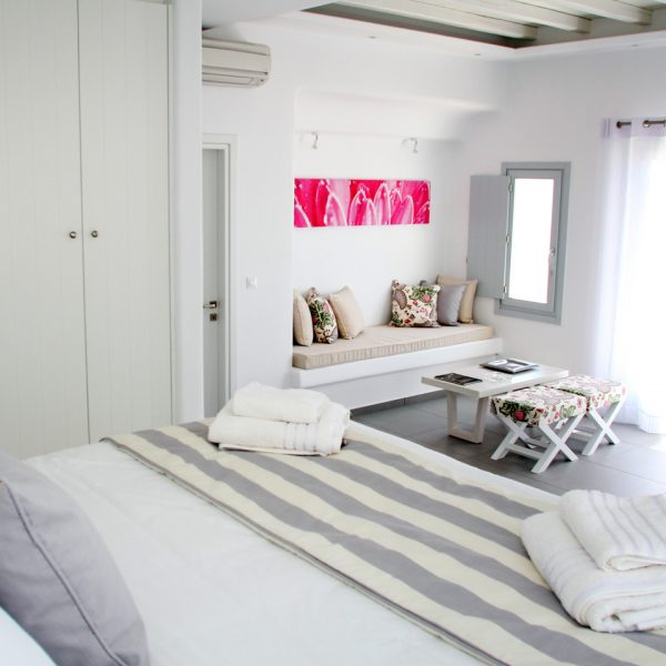 Open plan bedroom & living room of the luxury sea view Hera Villa with private pool in Mykonos