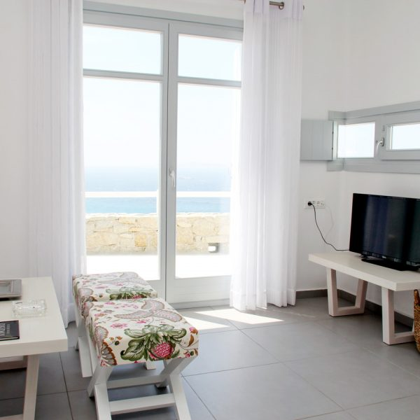 The private pool Hera Villa sitting room area with TV by the Houlakia Bay sea view balcony veranda