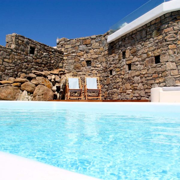 The deckchairs by the Hera Villa in Mykonos private pool are ideal for enjoying the sun & sea view