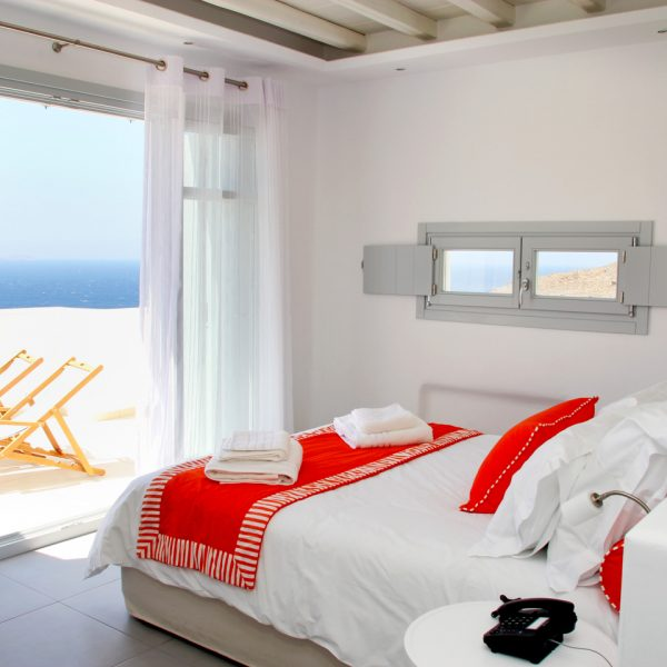 The bed in the San Marco Mykonos Hotel Asteria Villa facing the Houlakia Bay sea view veranda