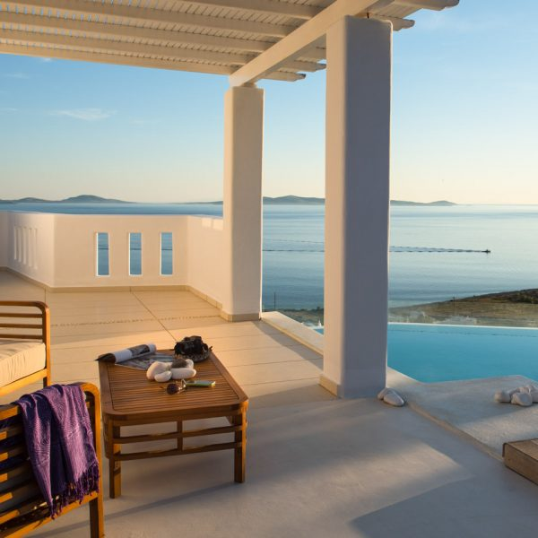 Furniture on the sea view pergola veranda beside the private pool at the Asteria Villa in Mykonos