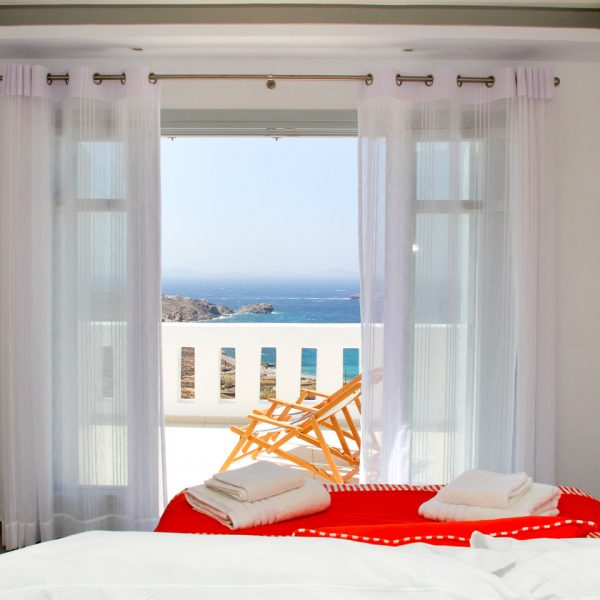 The view from a bed of the Asteria Villa balcony veranda overlooking the sea & Houlakia Bay, Mykonos
