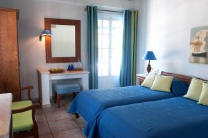 Twin beds in the luxury Classic Mykonian Rooms at the San Marco luxury Houlakia Bay Hotel in Mykonos