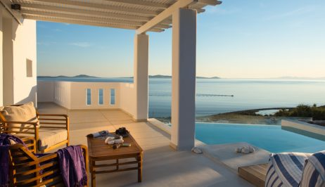 A sea view veranda above a pool at San Marco Luxury Hotel & Villas in Houlakia Bay, Mykonos