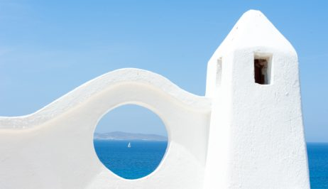 Ferry boat arriving to Mykonos island, as seen from the San Marco Mykonos Hotel grounds.