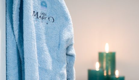 A fluffy robe & candles in the Houlakia Boutique Spa at San Marco Luxury Hotel & Villas in Mykonos