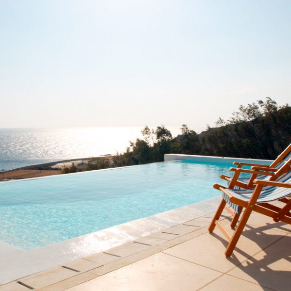 The San Marco Leto Villa in Mykonos has a private sea view infinity pool with terrace & deck chairs