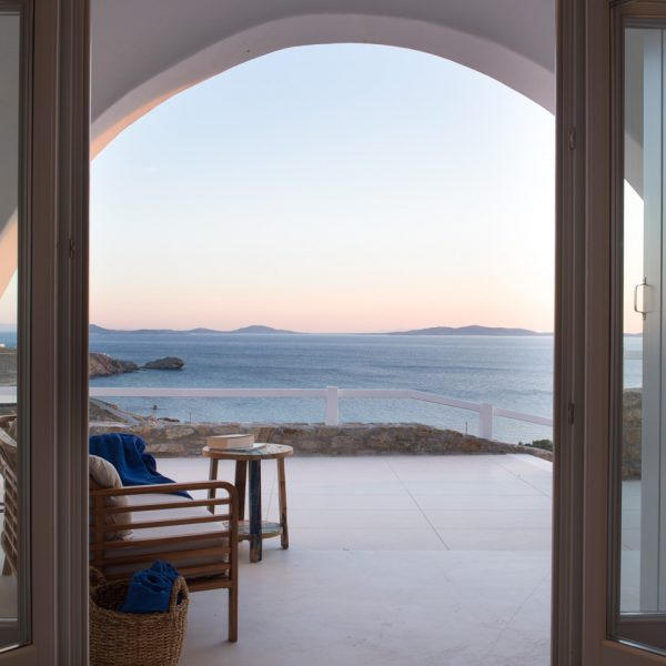 The San Marco Mykonos Leto Villa private veranda offers spectacular sunset sea views of Houlakia Bay