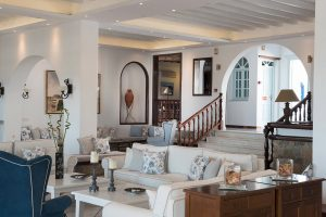 Public lounge sitting area of San Marco luxury Hotel in Houlakia Bay, Mykonos with comfortable sofas