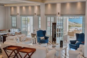 Sofas, armchairs & tables in public lounge area at San Marco Mykonos luxury Hotel in Houlakia Bay