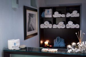 The San Marco Mykonos Spa reception area with towels and bath robes.