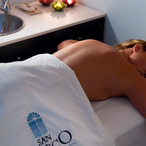 A San Marco Luxury Hotel guest, enjoying massage therapy in the Houlakia Boutique Spa in Mykonos.